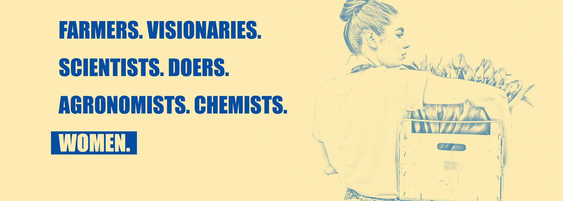 """Mujer cargando una caja de tulipanes y el texto """"Farmers.Visionaries.Scientists.Doers.Agronomists.Chemists.Women"""""""